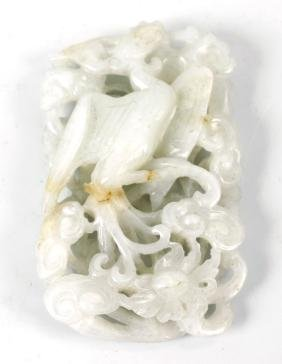 A Chinese white jade pendant, of oblong form with