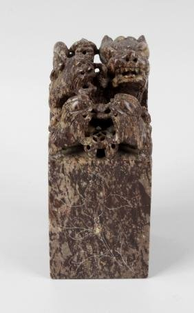 A large Chinese soapstone 'seal' with carved 'dog of