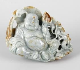 A Chinese carved jade figurine, modelled as a reclining
