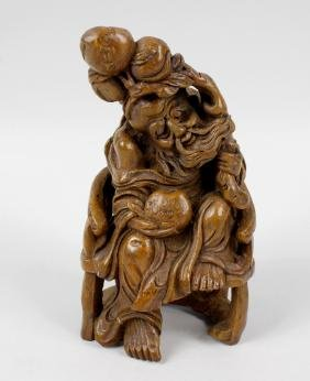 A 19th century carved bamboo figure, modelled as an