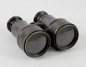 A cased pair of Lemaire field glasses. The eyepieces