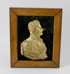 A cast gilt metal relief bust of the Duke of