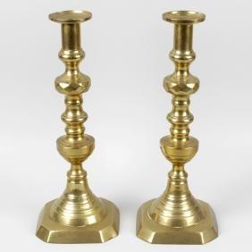 A large pair of Victorian brass candlesticks, each