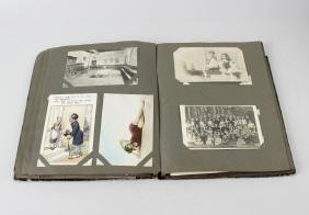 Three early 20th century postcard albums, each