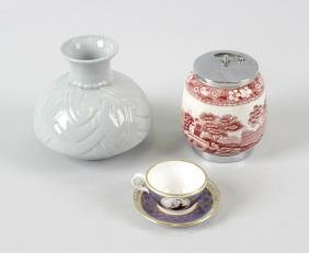 A box containing assorted ceramics and collectables. To