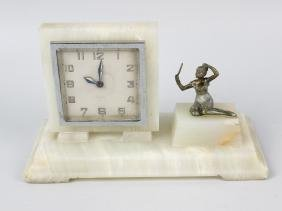 An Art Deco marble cased mantel clock, the squared
