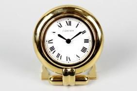 A Must de Cartier lacquered brass 'Pendulette Colisee'