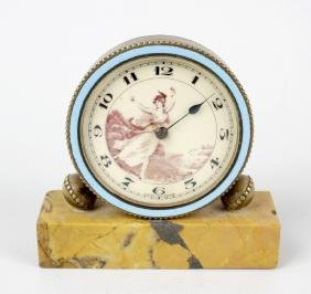 A late 19th century miniature clock, the circular dial