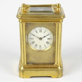 A brass-cased mignonette miniature carriage clock. The
