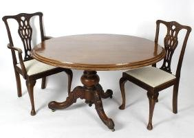 A Victorian mahogany oval shaped snap top table, the