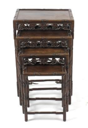 A nest of four Chinese carved hardwood occasional