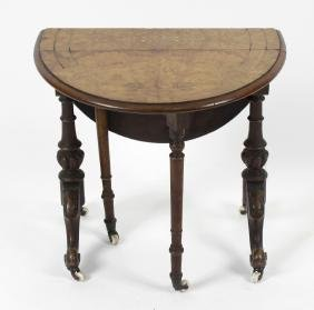 A small Victorian walnut Sutherland table, the oval