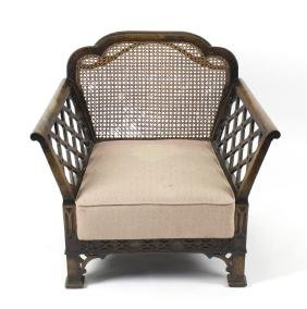 An early 20th century bergere chair. The shaped