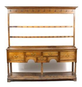A late George III oak potboard dresser and rack. Early