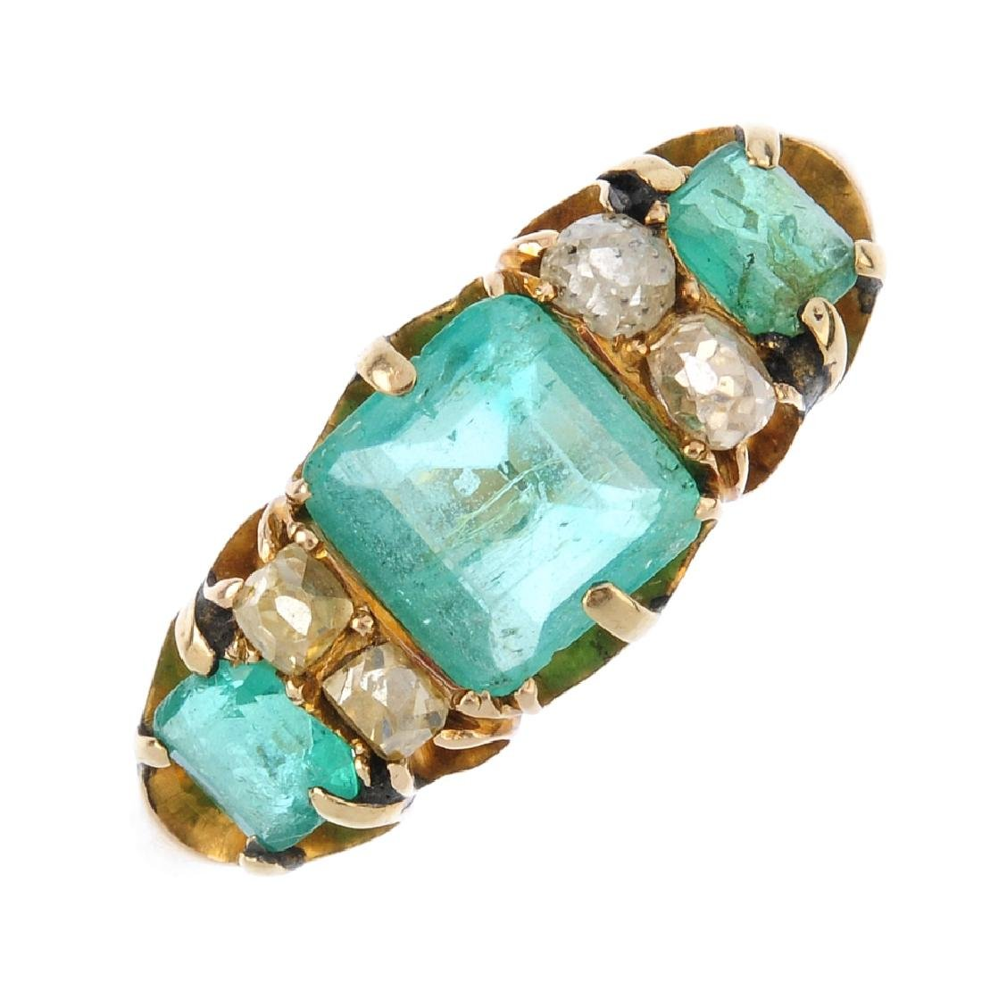 An emerald and diamond dress ring. The square-shape
