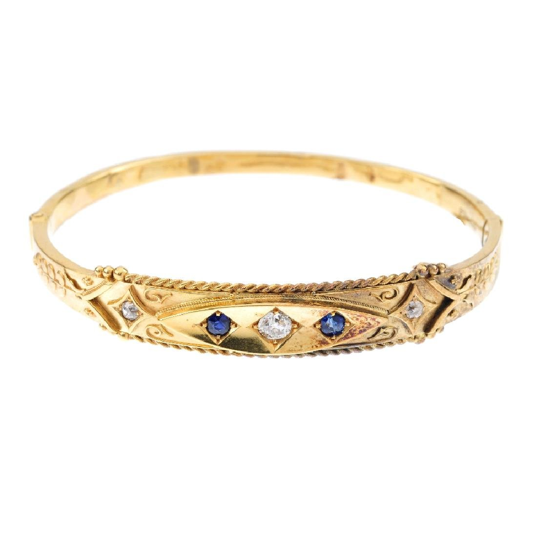 A late Victorian 15ct gold diamond and sapphire hinged