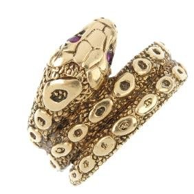 A gem-set snake ring. The coiled snake, with red-gem