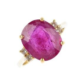 An 18ct gold glass-filled ruby dress ring. The