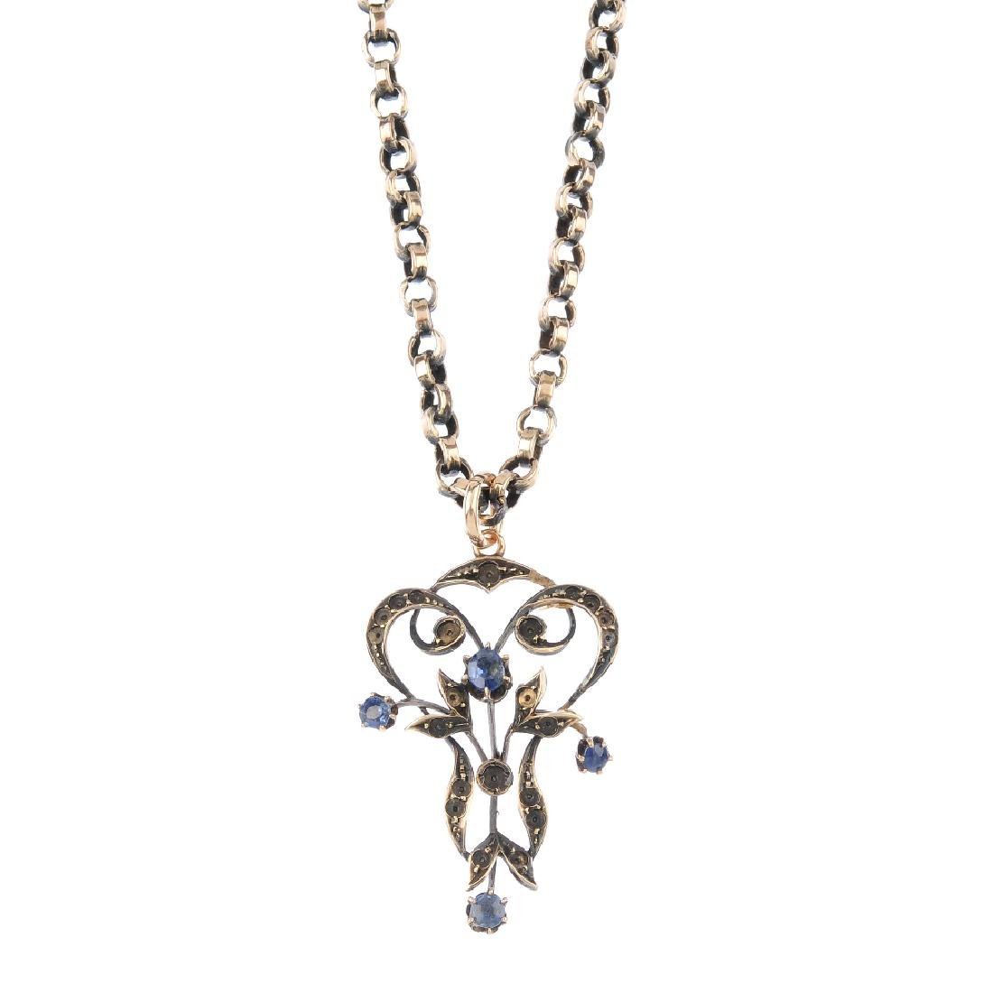 A sapphire pendant. Of openwork design, the central