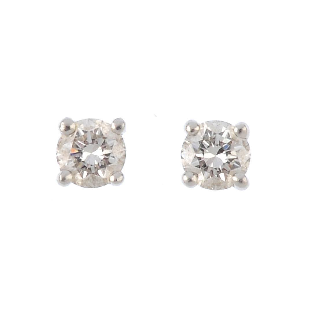 TIFFANY & CO. - pair of platinum diamond stud earrings.