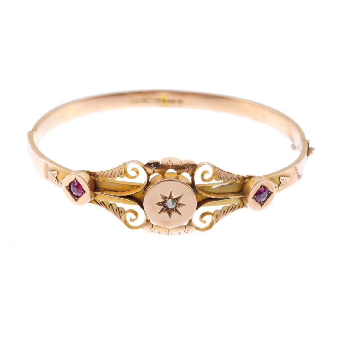 An early 20th century 9ct gold ruby and diamond hinged