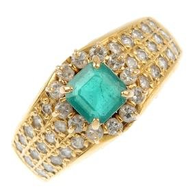 An emerald and diamond ring and a pair of earrings. An
