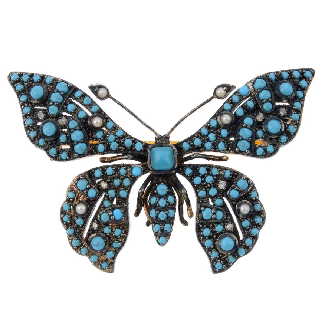 A turquoise and seed pearl butterfly brooch. The brooch