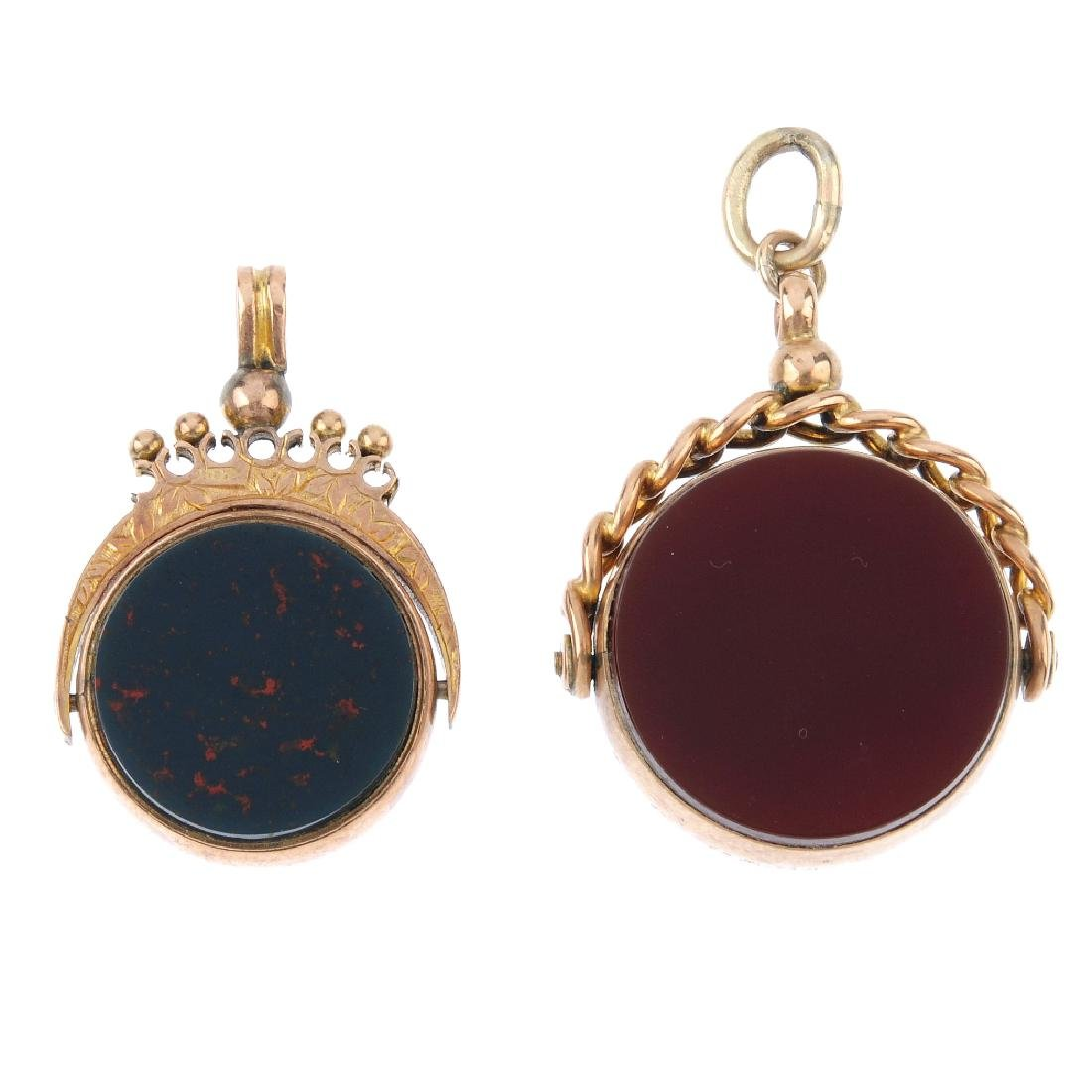 Two 9ct gold hardstone swivel fobs. To include a late