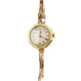 A lady's 1920s 18ct gold manual wind wristwatch. The