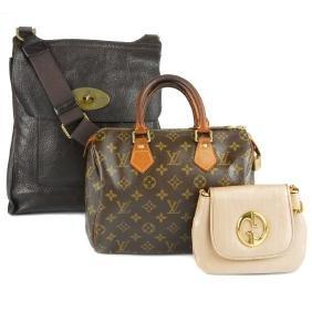 (7407) A group of three designer handbags. To include a