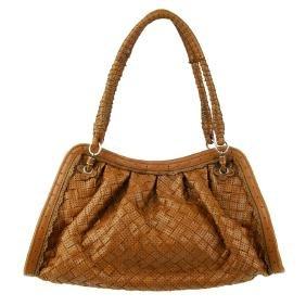 BOTTEGA VENETA - a tan Intrecciato leather handbag.