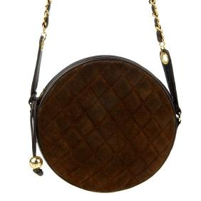 CHANEL - a vintage round quilted handbag. Featuring a