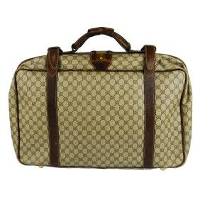 GUCCI - a vintage GG Supreme suitcase. Featuring