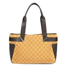 GUCCI - a handbag. Designed with a monogram patterned