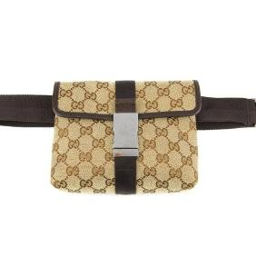 GUCCI - a canvas waist pouch. With maker's signature