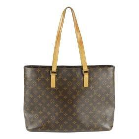 LOUIS VUITTON - a Monogram Luco handbag. Designed with