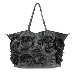 VALENTINO GARAVANI - a black leather flower handbag.