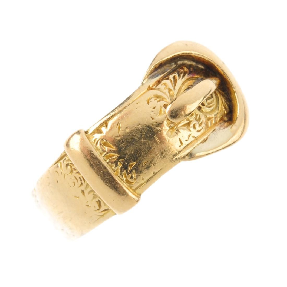 A late Victorian 18ct gold buckle ring. The front