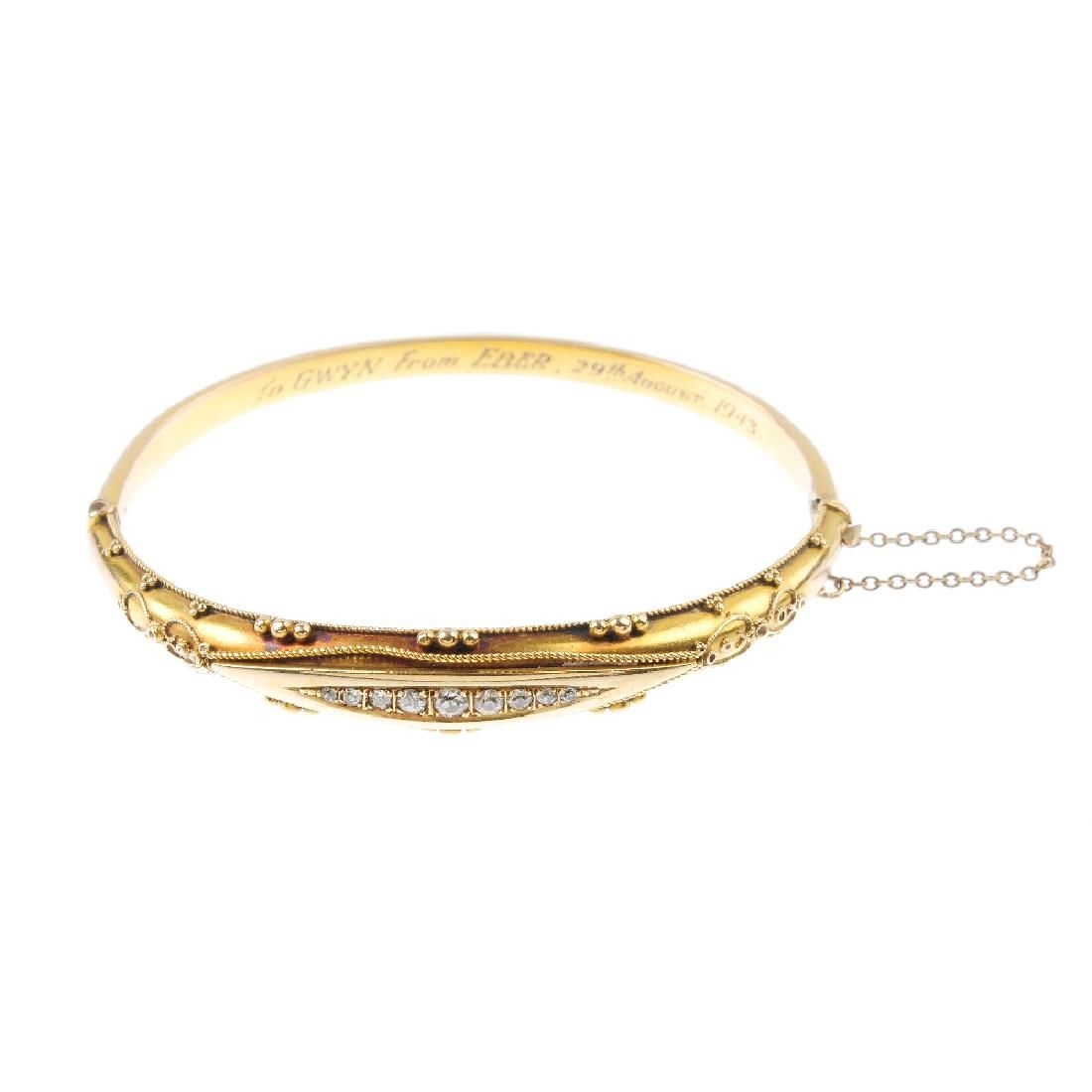 A late Victorian 15ct gold diamond hinged bangle.
