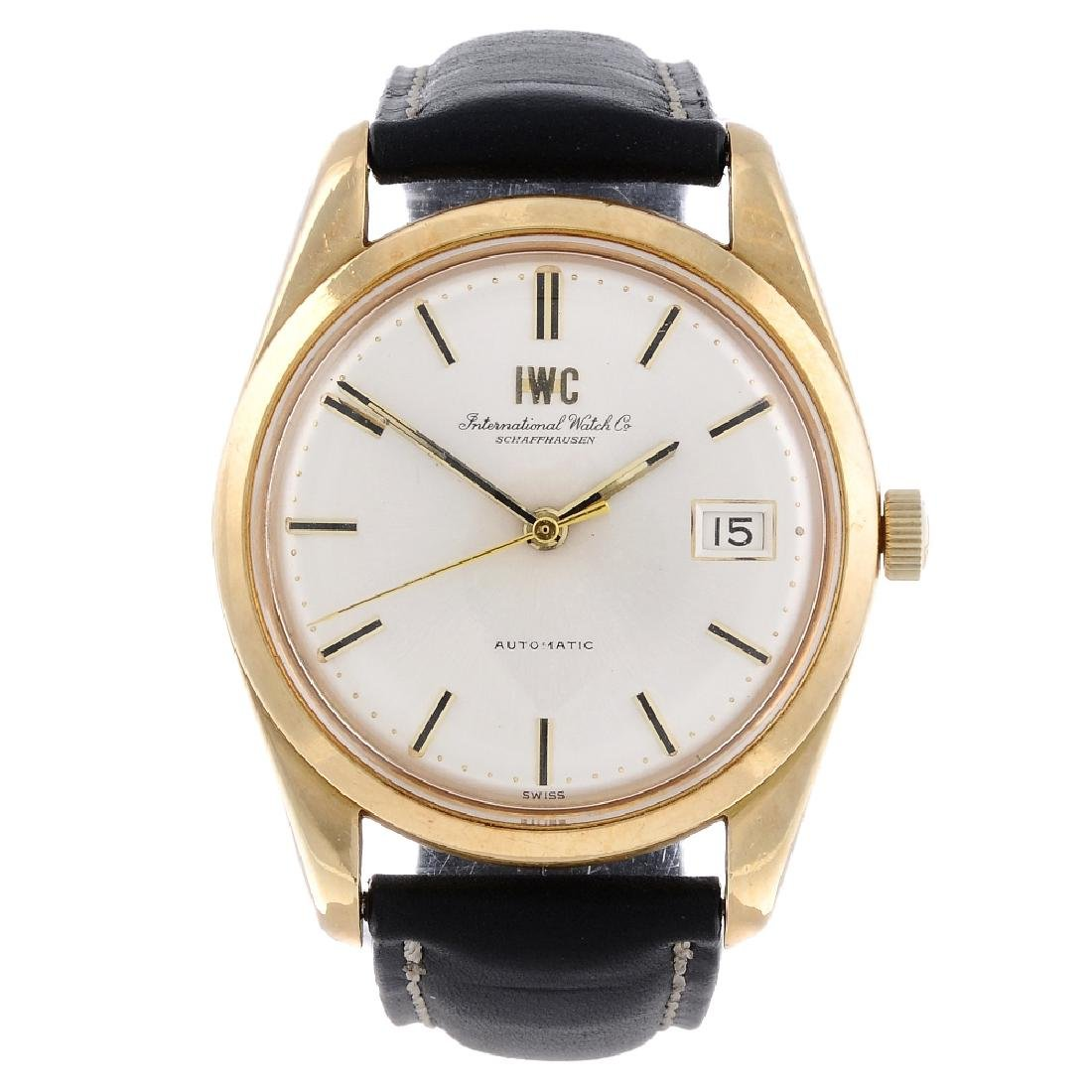 IWC - a gentleman's wrist watch. Yellow metal case with