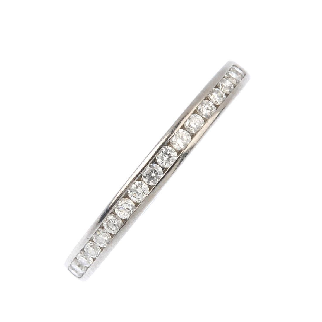 TIFFANY & CO. - a platinum diamond half eternity ring.