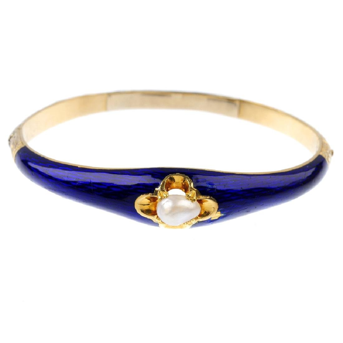An enamel and cultured pearl hinged bangle. The baroque