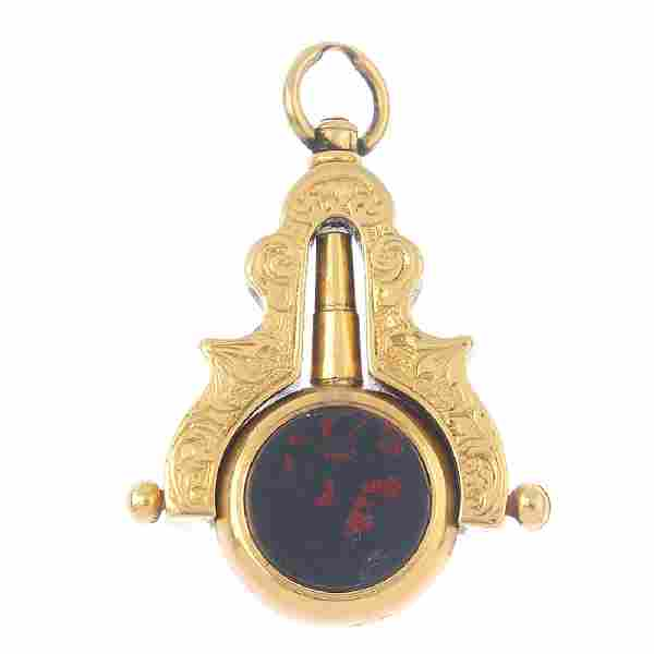 A late Victorian gold hardstone swivel watch key. The