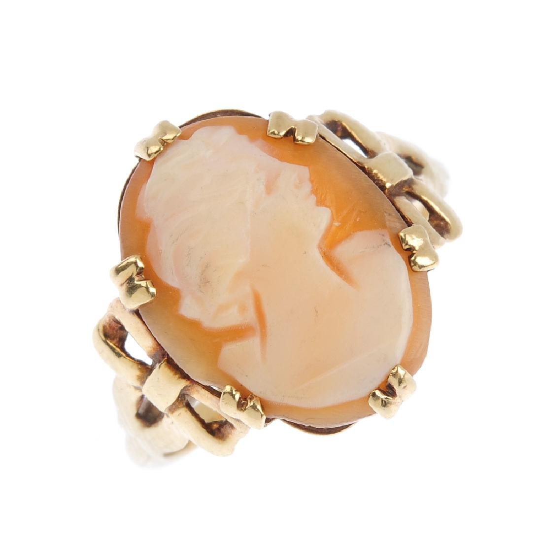 A cameo ring and a pair of cameo earrings. Each carved