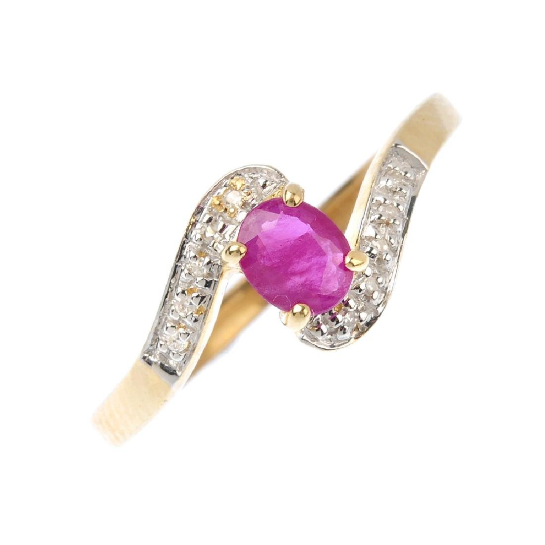 A 9ct gold ruby and diamond ring. The oval-shape ruby,