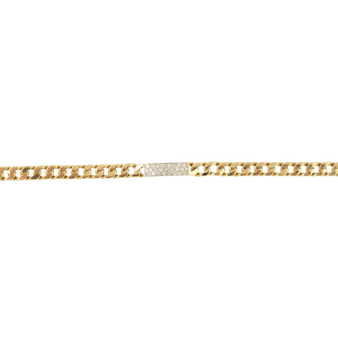 An 18ct gold diamond bracelet. The flat curb-link