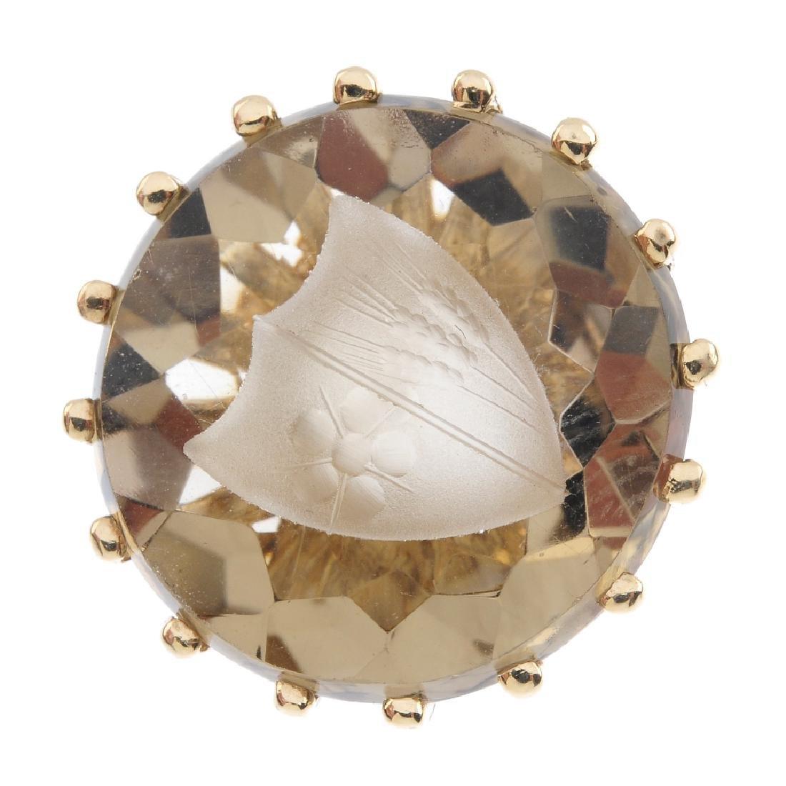 A gold smoky quartz signet ring. The circular smoky
