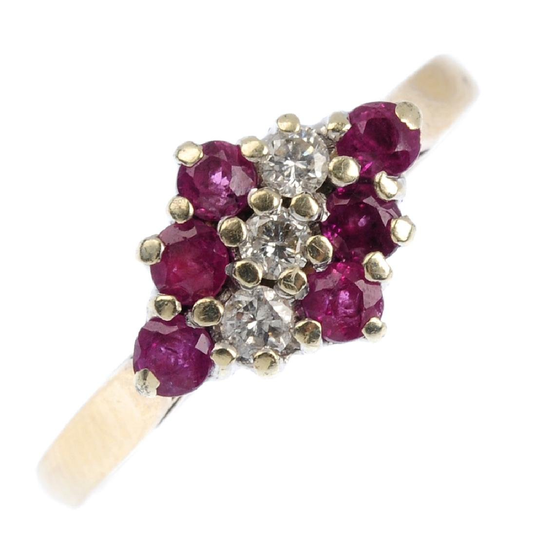 A 9ct gold diamond and ruby dress ring. Of