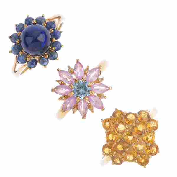 Four 9ct gold gem-set rings. To include a blue zircon,