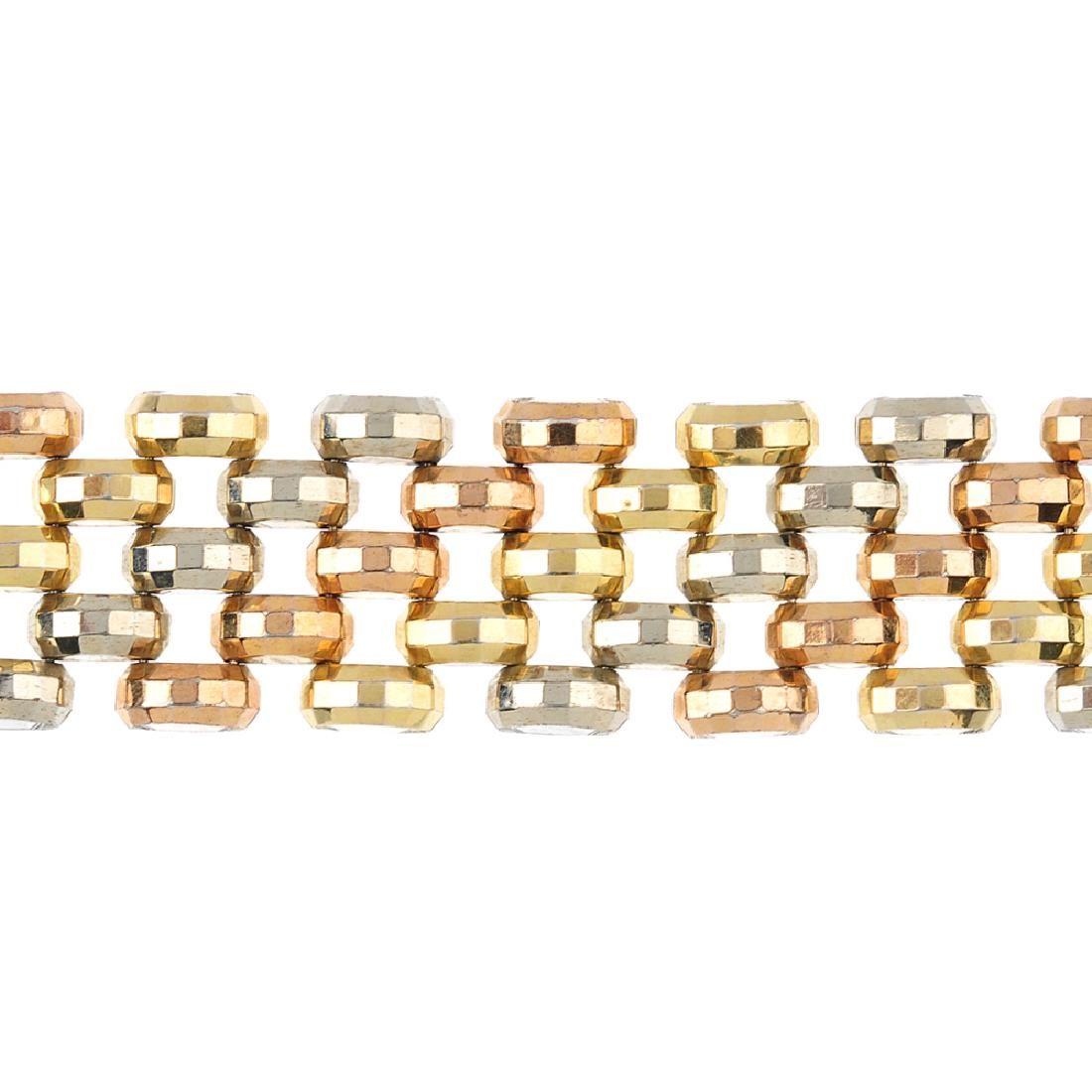 A bracelet. Of tri-colour design, comprised of